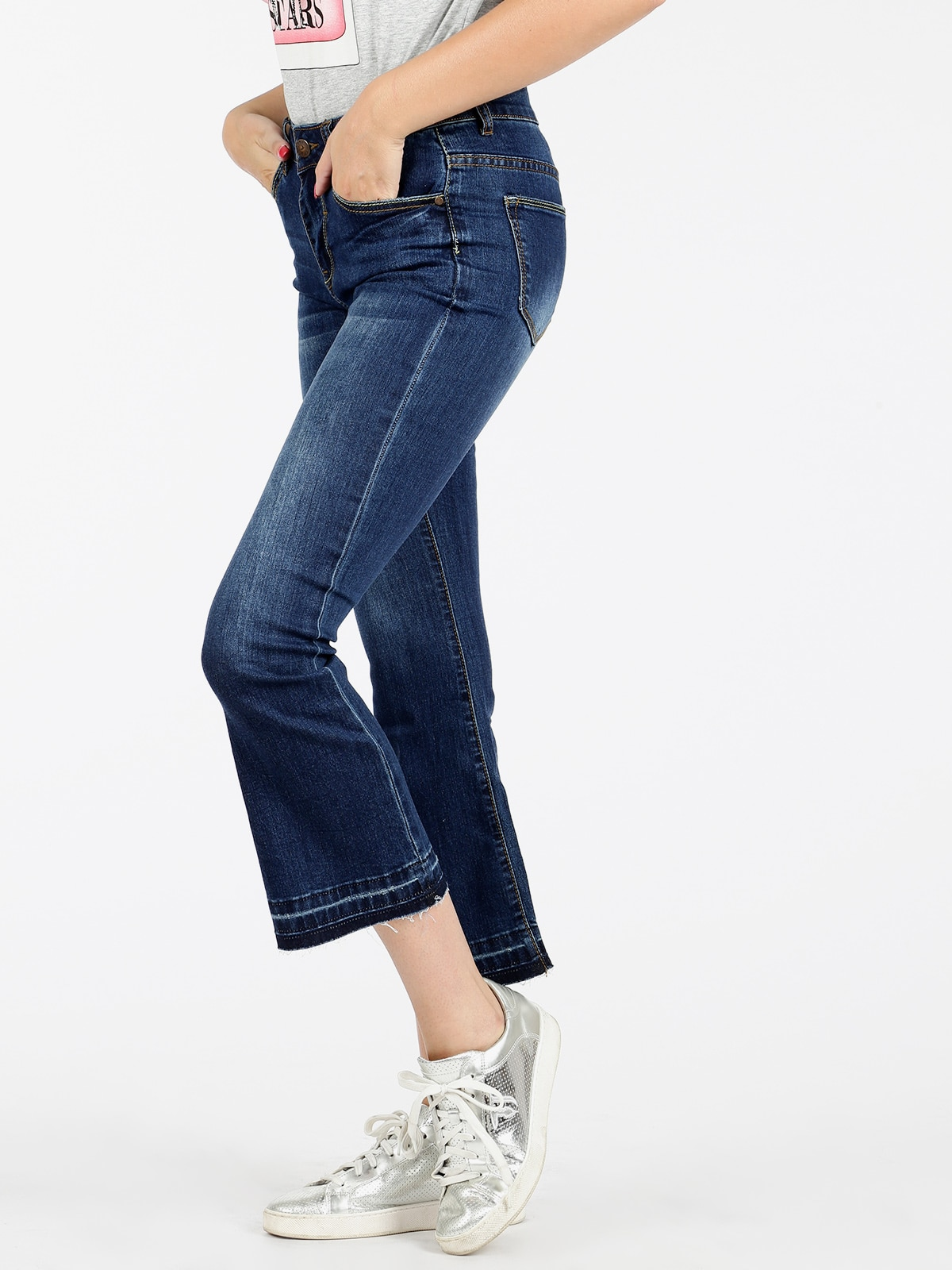 Woman flare jeans vertical straight three quarter flare trousers 1